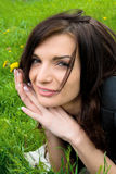 Young sexy woman on the park with flower. Royalty Free Stock Photography