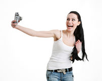 Young, sexy, woman photographing themselves. Young, sexy, woman photographing themselves retro camera, isolated on a white background Royalty Free Stock Photos