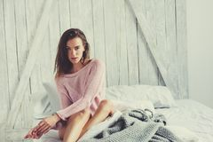 Young sexy woman in pink lingerie relaxing at home in bed Stock Images