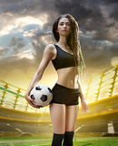 Young woman player in soccer stadium Royalty Free Stock Images