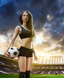 Young woman player in soccer stadium Stock Image