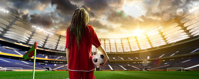 Young woman player in soccer stadium royalty free stock photos