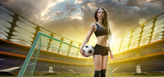 Young sexy woman player in soccer stadium Stock Images