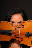 Young sexy woman playing violin Stock Image