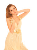 Young sexy woman portrait, isolated. Young sexy woman in golden dress, isolated Royalty Free Stock Images