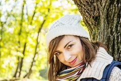 Young woman posing in autumn park, seasonal fashion. Young caucasian woman posing in autumn park. Seasonal fashion. Female portrait. Vibrant colors royalty free stock image