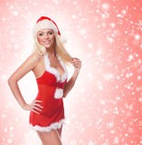 A young and sexy woman posing in Santa lingerie Royalty Free Stock Photos