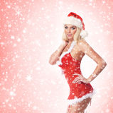 A young and sexy woman posing in Santa lingerie Stock Photos