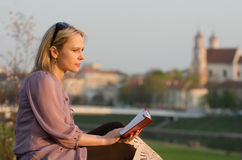 Young sexy woman reading a book in Vilnius, Lithuania Royalty Free Stock Photography
