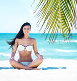 Young and sexy woman relaxing on the beach Royalty Free Stock Photography