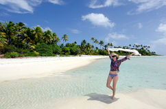 Young sexy woman relaxing on a deserted tropical island Stock Photo