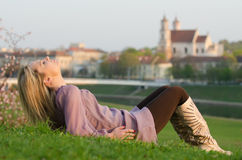 Young sexy woman relaxing in the evening Stock Image