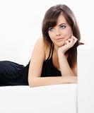 Young sexy woman relaxing on a sofa Stock Photography