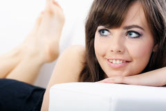 Young woman relaxing on a sofa Stock Image