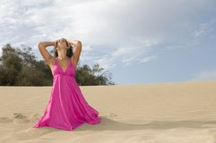 Young sexy woman in the sand near the sea Royalty Free Stock Photo