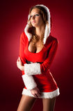 Young sexy woman in santa clothing Stock Photography