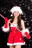 Young and sexy woman in santa costume with snow Royalty Free Stock Photos