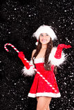Young and sexy woman in santa costume with snow Royalty Free Stock Image
