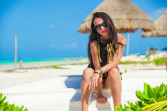 Young sexy woman sitting on a boat in white sandy Royalty Free Stock Images