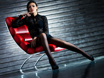 Young sexy woman sitting on chair Stock Photography