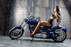 Young sexy woman sitting on motorcycle. Royalty Free Stock Photos