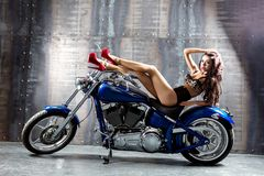 Young sexy woman sitting on motorcycle. Stock Images