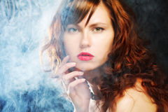 Young and woman in smoke Royalty Free Stock Image