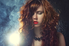 Young and woman in smoke Stock Images