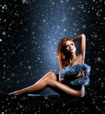 Young sexy woman on a snowy retro background Royalty Free Stock Photos