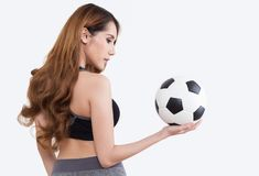 Young woman with soccer ball. Young woman in sports ware with soccer ball isolated on white background royalty free stock images