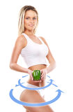 Young sexy woman in sporty clothes with an exotic fruit. Female body with the drawing arrows on it isolated on white. Healthy eating concept Royalty Free Stock Photography