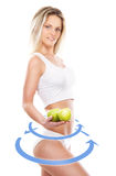 Young sexy woman in sporty clothes with an exotic fruit in her h Royalty Free Stock Photography