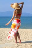 Young sexy woman standing at the beach. Young sexy woman standing at tropical beach, facing the ocean Stock Photography