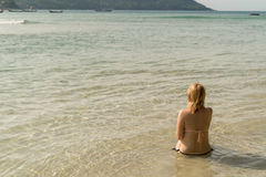 Young sexy woman sunbathing in sea Stock Photos