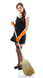Young woman sweeping the floor Stock Photography