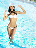 Young and sexy woman in a swimsuit posing in the swimming pool Royalty Free Stock Image