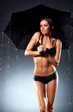 Young sexy woman with umbrella Royalty Free Stock Image