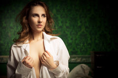 Young sexy woman uncovering her breast in shirt Stock Images