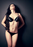 Young sexy woman on wall background Royalty Free Stock Image