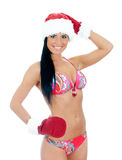 Young woman wearing bikini and christmas hat Royalty Free Stock Photography