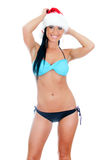 Young sexy woman wearing bikini and christmas hat Stock Photography