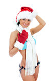 Young woman wearing bikini and christmas hat and gloves Stock Images