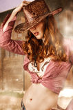 Woman wearing cowboy hat Stock Photos