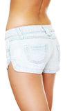 Young sexy woman wearing jean shorts  Royalty Free Stock Photography