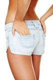 Young sexy woman wearing jean shorts Stock Image