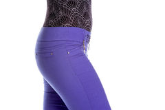 Young sexy woman is wearing purple jeans. Rear view. Isolated image Stock Photo