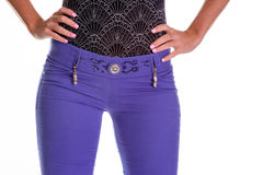 Young sexy woman is wearing purple jeans. Rear view. Isolated image Royalty Free Stock Photo