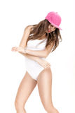 Young woman in white bodysuit and pink cap dancing on white background Stock Image