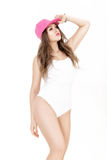 Young woman in white bodysuit  and pink cap posing on white background Stock Image