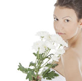 Young woman with a white flower. Royalty Free Stock Images